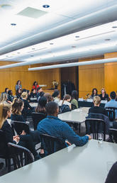 Students and mentors at the Haskayne School of Business listen to five panelists at the Women in Finance event on Jan. 28 hosted by the Haskayne Career Centre and the Canadian Centre for Advanced Leadership in Business.