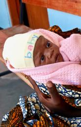 Known locally as Mama na Mtoto (mother and baby in Swahili), UCalgary's Cumming School of Medicine project provides on-the-ground clinical, education and research support to help mothers and babies. Here, a two-day-old baby awaits a checkup at a health facility in Misunwi District, Tanzania. Photo by Ashley Anderson