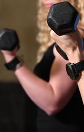 Closeup of two people doing bicep curls.