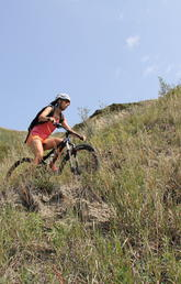 Mountain biker riding the trails in Nose Hill Park, Calgary
