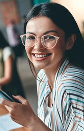 Smiling young woman in co-working space