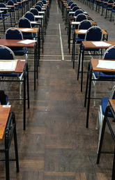 desks with exam papers