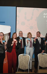 UCalgary faculty and staff hold up their microbiome personality cards.