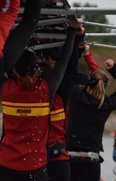 Rowing club members volunteering