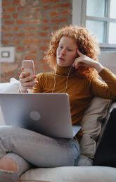 Woman on laptop and phone