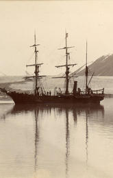 Photo of the Nova Zembla at anchor in front of a glacier, potentially Bylot Island, date unknown.