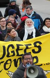 Protesters with sign saying 'Refugees welcome'