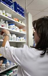 A lab technician prepares a prescription at a pharmacy in Quebec City on March 8, 2020