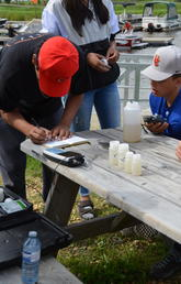 Sucker Creek First Nation Students record measurements taken from water samples.