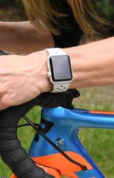 Cyclist riding while wearing a smart watch