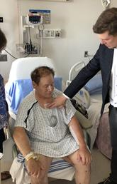 Dr. Corey Adams checks up on Darrell Parker, who underwent five heart bypass procedures.