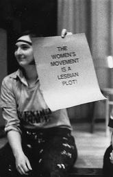 Women holding women's movement signs