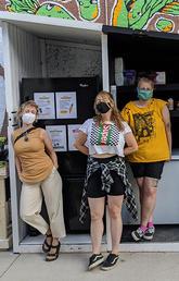 The Calgary Community Fridge organizers with the fridge.