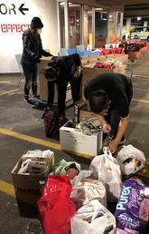 LSE student staff sort and organize community food donations