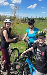 Nicole with her kids out for a bike ride. Biking is an important part of Nicole's routine.
