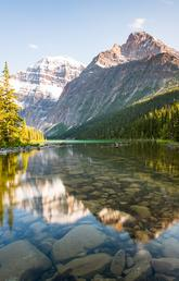 Lake in Jasper National Park, with mountains in background