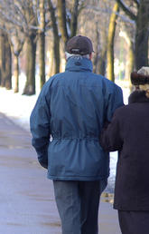 Seniors walking in springtime snow