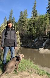 Graduating with an MA in Geography, Kristy Myles enjoys a walk in Fish Creek Park with her dog, Whiskey.