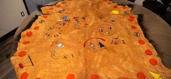 Buffalo robe tells story of ii' taa'poh'to'p through symbols