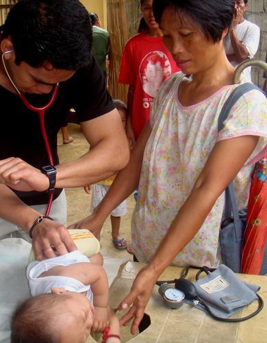 ADZU-SOM resident assessing an infant.